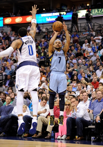 Apr 15, 2013; Dallas, TX, USA; Memphis Grizzlies point guard Jerryd Bayless (7) makes a jump shot over Dallas Mavericks small forward Shawn Marion (0) during the second half at the American Airlines Center. The Grizzlies defeated the Mavericks 103-97. Mandatory Credit: Jerome Miron-USA TODAY Sports