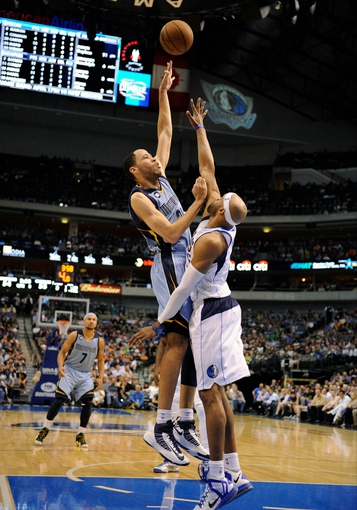 Apr 15, 2013; Dallas, TX, USA; Memphis Grizzlies small forward Tayshaun Prince (21) shoots over Dallas Mavericks shooting guard Vince Carter (25) during the second half at the American Airlines Center. The Grizzlies defeated the Mavericks 103-97. Mandatory Credit: Jerome Miron-USA TODAY Sports