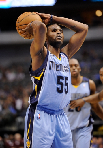 Apr 15, 2013; Dallas, TX, USA; Memphis Grizzlies point guard Keyon Dooling (55) makes a free throw during the second half of the game against the Dallas Mavericks at the American Airlines Center. The Grizzlies defeated the Mavericks 103-97. Mandatory Credit: Jerome Miron-USA TODAY Sports