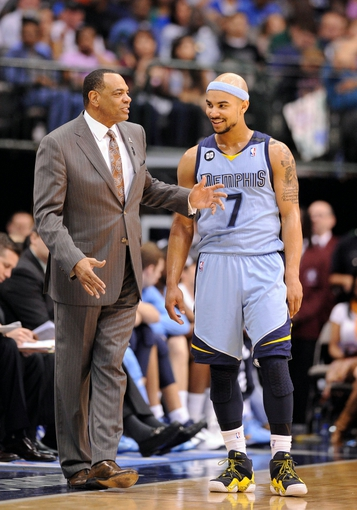 Apr 15, 2013; Dallas, TX, USA; Memphis Grizzlies head coach Lionel Hollins and point guard Jerryd Bayless (7) talk during a time out in the the second half of the game between the Dallas Mavericks and the Grizzlies at the American Airlines Center. The Grizzlies defeated the Mavericks 103-97. Mandatory Credit: Jerome Miron-USA TODAY Sports