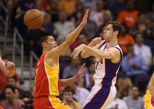 Apr. 15, 2013; Phoenix, AZ, USA: Phoenix Suns guard Goran Dragic (right) passes the ball under pressure from Houston Rockets guard Jeremy Lin in the first half at the US Airways Center. Mandatory Credit: Mark J. Rebilas-USA TODAY Sports