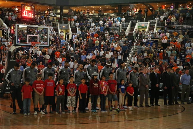 Apr. 15, 2013; Phoenix, AZ, USA: Phoenix Suns players observe a moment of silence in memory of the Boston Marathon bombings prior to the game against the Houston Rockets at the US Airways Center. Mandatory Credit: Mark J. Rebilas-USA TODAY Sports