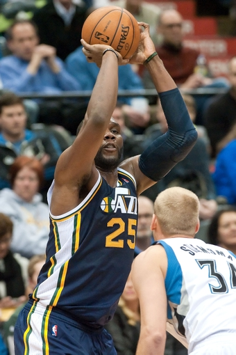 Apr 15, 2013; Minneapolis, MN, USA; Utah Jazz center Al Jefferson (25) shoots the ball and Minnesota Timberwolves center Greg Stiemsma (34) defends in the second quarter at Target Center. The Jazz won 96-80. Mandatory Credit:  Greg Smith-USA TODAY Sports
