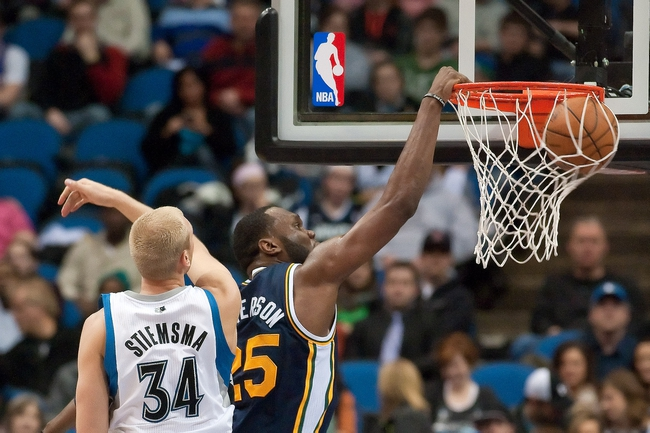 Apr 15, 2013; Minneapolis, MN, USA; Utah Jazz center Al Jefferson (25) dunks the ball and Minnesota Timberwolves center Greg Stiemsma (34) defends in the second quarter at Target Center. The Jazz won 96-80. Mandatory Credit:  Greg Smith-USA TODAY Sports