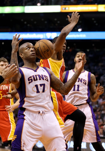 Apr. 15, 2013; Phoenix, AZ, USA: Phoenix Suns forward P.J. Tucker (17) is hit in the face by the ball as he reaches for a rebound in the second half against the Houston Rockets at the US Airways Center. The Suns defeated the Rockets 119-112. Mandatory Credit: Mark J. Rebilas-USA TODAY Sports