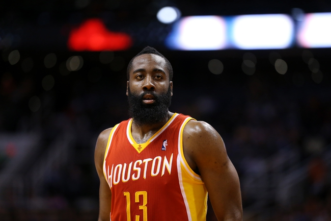 Apr. 15, 2013; Phoenix, AZ, USA: Houston Rockets guard James Harden against the Phoenix Suns at the US Airways Center. The Suns defeated the Rockets 119-112. Mandatory Credit: Mark J. Rebilas-USA TODAY Sports