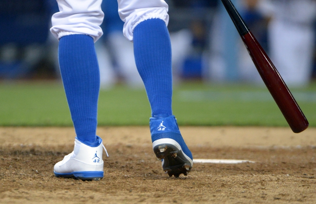 Apr 15, 2013; Los Angeles, CA, USA; Los Angeles Dodgers left fielder Carl Crawford wears Nike jumpman spikes with the No. 42 in honor of the late Jackie Robinson during the game against the San Diego Padres at Dodger Stadium.. Mandatory Credit: Kirby Lee-USA TODAY Sports