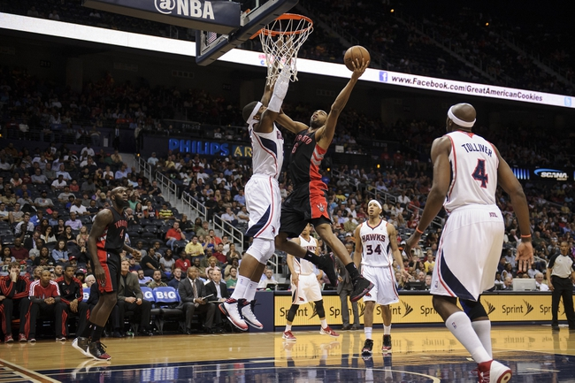 Apr 16, 2013; Atlanta, GA, USA; Toronto Raptors shooting guard Alan Anderson (6) drives to the basket against Atlanta Hawks small forward Josh Smith (5) during the first half at Philips Arena. Mandatory Credit: Paul Abell-USA TODAY Sports