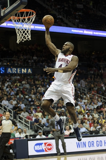 Apr 16, 2013; Atlanta, GA, USA; Atlanta Hawks power forward Ivan Johnson (44) goes up for a dunk against the Toronto Raptors during the second half at Philips Arena. The Raptors won 113-96. Mandatory Credit: Paul Abell-USA TODAY Sports