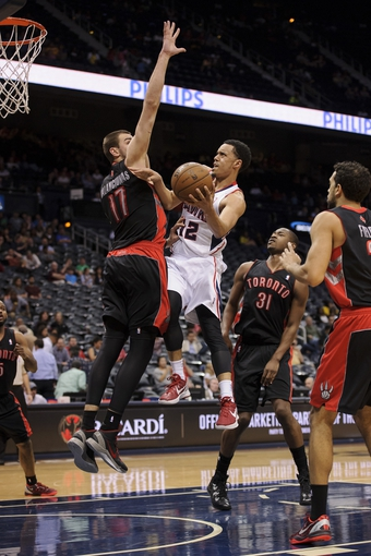 Apr 16, 2013; Atlanta, GA, USA; Toronto Raptors center Jonas Valanciunas (17) locks Atlanta Hawks shooting guard John Jenkins (12) as he attempts to drive to the basket during the second half at Philips Arena. The Raptors won 113-96. Mandatory Credit: Paul Abell-USA TODAY Sports