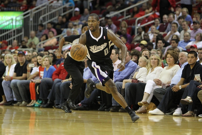 April 14, 2013; Houston, TX, USA; Sacramento Kings point guard Toney Douglas (0) dribbles the ball against the Houston Rockets in the fourth quarter at the Toyota Center. The Rockets defeated the Kings 121-100. Mandatory Credit: Brett Davis-USA TODAY Sports