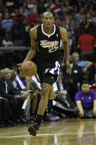 April 14, 2013; Houston, TX, USA; Sacramento Kings small forward Travis Outlaw (25) dribbles the ball against the Houston Rockets in the fourth quarter at the Toyota Center. The Rockets defeated the Kings 121-100. Mandatory Credit: Brett Davis-USA TODAY Sports