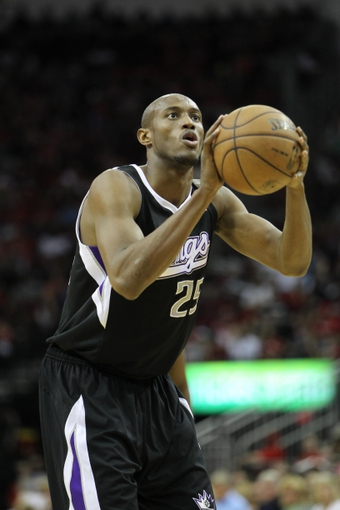 April 14, 2013; Houston, TX, USA; Sacramento Kings small forward Travis Outlaw (25) shoots a free throw against the Houston Rockets in the fourth quarter at the Toyota Center. The Rockets defeated the Kings 121-100. Mandatory Credit: Brett Davis-USA TODAY Sports