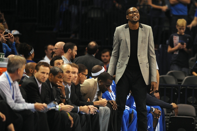 Apr 17, 2013; Oklahoma City, OK, USA; Oklahoma City Thunder forward Kevin Durant (35) watches from the bench as his team plays the Milwaukee Bucks during the first half at Chesapeake Energy Arena. Mandatory Credit: Mark D. Smith-USA TODAY Sports
