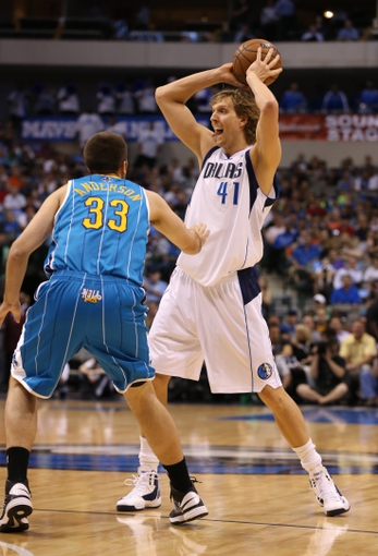 Apr 17, 2013; Dallas, TX, USA; Dallas Mavericks forward Dirk Nowitzki (41) passes the ball against the New Orleans Hornets at American Airlines Center. Mandatory Credit: Matthew Emmons-USA TODAY Sports