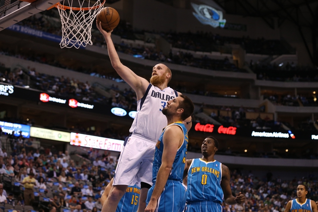 Apr 17, 2013; Dallas, TX, USA; Dallas Mavericks center Chris Kaman (35) shoots against New Orleans Hornets forward Ryan Anderson (33) at American Airlines Center. Mandatory Credit: Matthew Emmons-USA TODAY Sports
