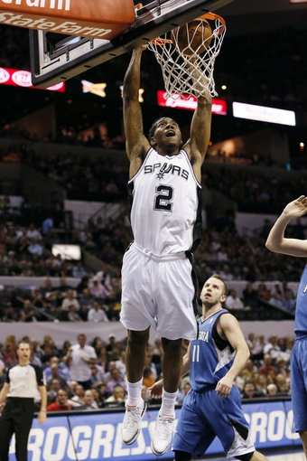 Apr 17, 2013; San Antonio, TX, USA; San Antonio Spurs forward Kawhi Leonard (2) dunks during the first half against the Minnesota Timberwolves  at the AT&T Center. Mandatory Credit: Soobum Im-USA TODAY Sports
