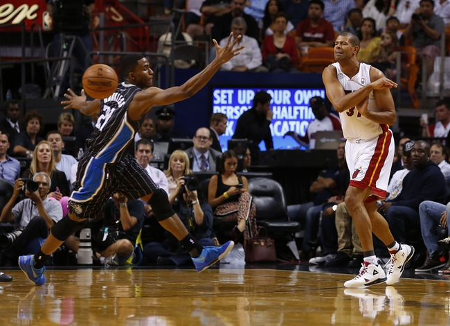 Apr 17, 2013; Miami, FL, USA;  Miami Heat small forward Shane Battier (31) passes the ball past Orlando Magic small forward Maurice Harkless (21) in the first quarter at the American Airlines Arena.  Mandatory Credit: Robert Mayer-USA TODAY Sports