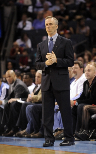 April 17, 2013; Charlotte, NC, USA; Charlotte Bobcats head coach Mike Dunlap reacts during the game at Time Warner Cable Arena. Mandatory Credit: Sam Sharpe-USA TODAY Sports