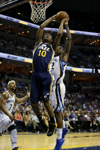 Apr 17, 2013; Memphis, TN, USA;  Utah Jazz point guard Alec Burks (10) shoots the ball against Memphis Grizzlies power forward Ed Davis (32) during the game at FedEx Forum.  Mandatory Credit: Spruce Derden   USA TODAY Sports