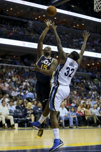 Apr 17, 2013; Memphis, TN, USA;  Utah Jazz power forward Derrick Favors (15) shoots the ball over Memphis Grizzlies power forward Ed Davis (32) during the game at FedEx Forum.  Mandatory Credit: Spruce Derden   USA TODAY Sports