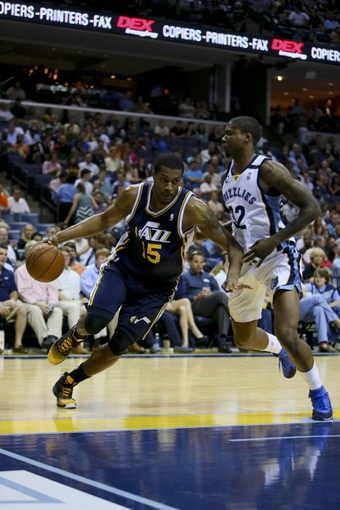 Apr 17, 2013; Memphis, TN, USA;  Utah Jazz power forward Derrick Favors (15) drives to the basket against Memphis Grizzlies power forward Ed Davis (32) during the game at FedEx Forum.  Mandatory Credit: Spruce Derden   USA TODAY Sports