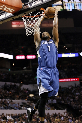 Apr 17, 2013; San Antonio, TX, USA; Minnesota Timberwolves  forward Derrick Williams (7) dunks during the second half against the San Antonio Spurs at the AT&T Center. The Timberwolves won 108-95.  Mandatory Credit: Soobum Im-USA TODAY Sports