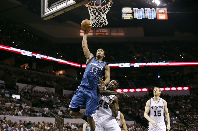 Apr 17, 2013; San Antonio, TX, USA; Minnesota Timberwolves  forward Dante Cunningham (33) drives to the basket past San Antonio Spurs forward DeJuan Blair (45) during the second half at the AT&T Center. The Timberwolves won 108-95.  Mandatory Credit: Soobum Im-USA TODAY Sports