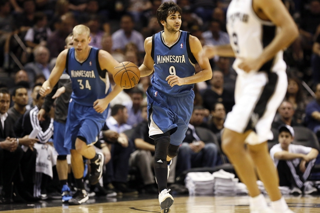 Apr 17, 2013; San Antonio, TX, USA; Minnesota Timberwolves  guard Ricky Rubio (9) brings the ball up court during the second half against the San Antonio Spurs at the AT&T Center. The Timberwolves won 108-95.  Mandatory Credit: Soobum Im-USA TODAY Sports