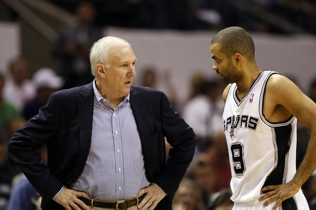 Apr 17, 2013; San Antonio, TX, USA; San Antonio Spurs head coach Gregg Popovich talks with guard Tony Parker (9) during the second half against the Minnesota Timberwolves at the AT&T Center. The Timberwolves won 108-95.  Mandatory Credit: Soobum Im-USA TODAY Sports