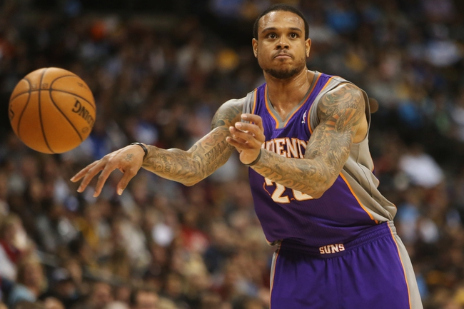 April 17, 2013; Denver, CO, USA; Phoenix Suns guard Shannon Brown (26) passes the ball during the second half against the Denver Nuggets at the Pepsi Center.  The Nuggets won 118-98.  Mandatory Credit: Chris Humphreys-USA TODAY Sports