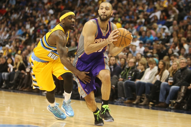 April 17, 2013; Denver, CO, USA; Phoenix Suns guard Kendall Marshall (12) drives to the basket past Denver Nuggets guard Ty Lawson (left) during the second half at the Pepsi Center.  The Nuggets won 118-98.  Mandatory Credit: Chris Humphreys-USA TODAY Sports