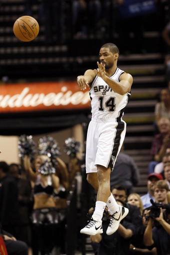 Apr 17, 2013; San Antonio, TX, USA; San Antonio Spurs guard Gary Neal (14) passes the ball during the second half against the Minnesota Timberwolves at the AT&T Center. The Timberwolves won 108-95.  Mandatory Credit: Soobum Im-USA TODAY Sports