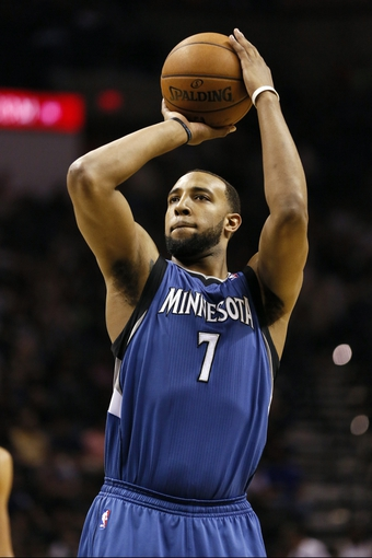 Apr 17, 2013; San Antonio, TX, USA; Minnesota Timberwolves  forward Derrick Williams (7) shoots a free throw during the second half against the San Antonio Spurs at the AT&T Center. The Timberwolves won 108-95.  Mandatory Credit: Soobum Im-USA TODAY Sports