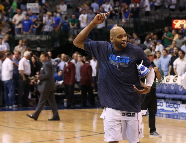 Apr 17, 2013; Dallas, TX, USA; Dallas Mavericks guard Vince Carter (25) waves to fans as he walks off the court after the game against the New Orleans Hornets at American Airlines Center. The Mavs beat the Hornets 99-87. Mandatory Credit: Matthew Emmons-USA TODAY Spor