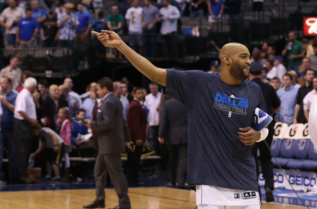 Apr 17, 2013; Dallas, TX, USA; Dallas Mavericks guard Vince Carter (25) waves to fans as he walks off the court after the game against the New Orleans Hornets at American Airlines Center. The Mavs beat the Hornets 99-87. Mandatory Credit: Matthew Emmons-USA TODAY Sports