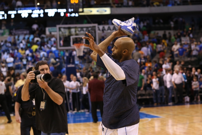 Apr 17, 2013; Dallas, TX, USA; Dallas Mavericks guard Vince Carter (25) throws his sneakers to the crowd as he walks off the court after the game against the New Orleans Hornets at American Airlines Center. The Mavs beat the Hornets 99-87. Mandatory Credit: Matthew Emmons-USA TODAY Sports