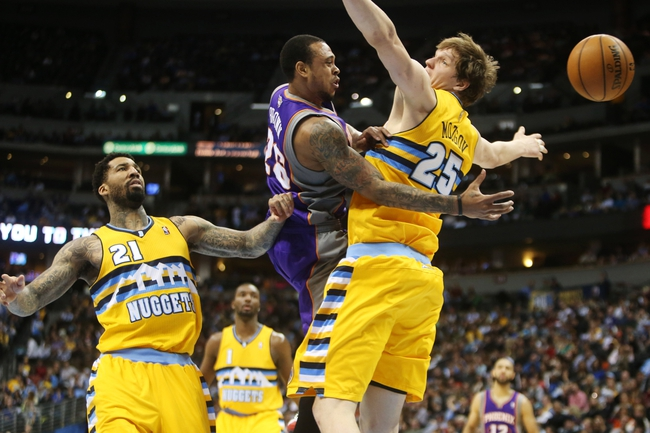 April 17, 2013; Denver, CO, USA; Phoenix Suns guard Shannon Brown (26) passes the ball around Denver Nuggets center Timofey Mozgov (25) as Nuggets forward Wilson Chandler (21) looks on during the second half at the Pepsi Center.  The Nuggets won 118-98.  Mandatory Credit: Chris Humphreys-USA TODAY Sports