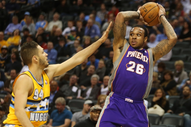 April 17, 2013; Denver, CO, USA; Phoenix Suns guard Shannon Brown (26) looks to pass the ball during the second half against the Denver Nuggets at the Pepsi Center.  The Nuggets won 118-98.  Mandatory Credit: Chris Humphreys-USA TODAY Sports