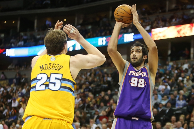 April 17, 2013; Denver, CO, USA; Phoenix Suns center Hamed Haddadi (98) shoots the ball during the second half against the Denver Nuggets at the Pepsi Center.  The Nuggets won 118-98.  Mandatory Credit: Chris Humphreys-USA TODAY Sports