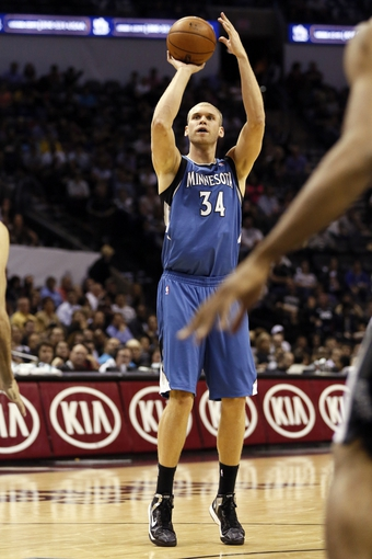 Apr 17, 2013; San Antonio, TX, USA; Minnesota Timberwolves  center Greg Stiemsma (34) shoots during the second half against the San Antonio Spurs at the AT&T Center. The Timberwolves won 108-95.  Mandatory Credit: Soobum Im-USA TODAY Sports