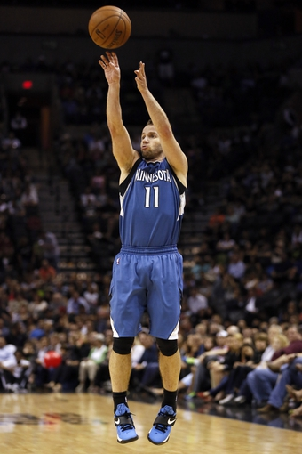 Apr 17, 2013; San Antonio, TX, USA; Minnesota Timberwolves  guard Jose Barea (11) shoots during the second half against the San Antonio Spurs at the AT&T Center. The Timberwolves won 108-95.  Mandatory Credit: Soobum Im-USA TODAY Sports