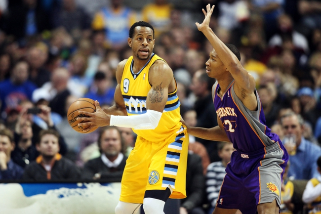April 17, 2013; Denver, CO, USA; Denver Nuggets guard Andre Iguodala (9) with the ball against Phoenix Suns forward Wesley Johnson (2) during the first half at the Pepsi Center.  The Nuggets won 118-98.  Mandatory Credit: Chris Humphreys-USA TODAY Sports