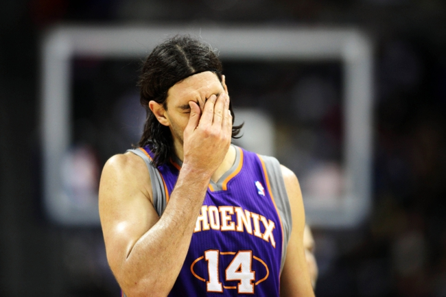 April 17, 2013; Denver, CO, USA; Phoenix Suns forward Luis Scola (14) reacts during the second half against the Denver Nuggets at the Pepsi Center.  The Nuggets won 118-98.  Mandatory Credit: Chris Humphreys-USA TODAY Sports
