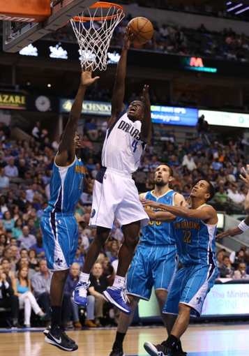 Apr 17, 2013; Dallas, TX, USA; Dallas Mavericks guard Darren Collison (4) shoots against the New Orleans Hornets at American Airlines Center. The Mavs beat the Hornets 99-87. Mandatory Credit: Matthew Emmons-USA TODAY Sports