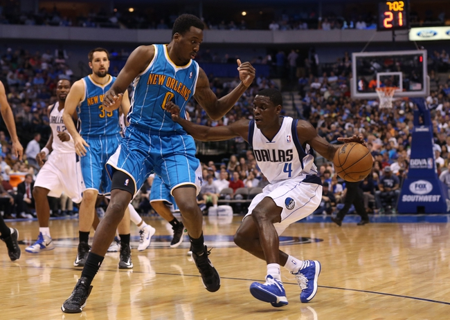 Apr 17, 2013; Dallas, TX, USA; Dallas Mavericks guard Darren Collison (4) drives against New Orleans Hornets forward Al-Farouq Aminu (0) at American Airlines Center. The Mavs beat the Hornets 99-87. Mandatory Credit: Matthew Emmons-USA TODAY Sports