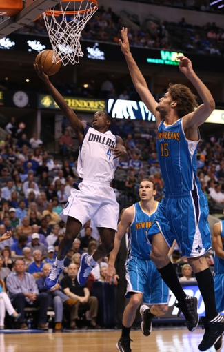 Apr 17, 2013; Dallas, TX, USA; Dallas Mavericks guard Darren Collison (4) shoots against New Orleans Hornets center Robin Lopez (15) at American Airlines Center. The Mavs beat the Hornets 99-87. Mandatory Credit: Matthew Emmons-USA TODAY Sports
