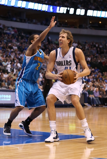 Apr 17, 2013; Dallas, TX, USA; Dallas Mavericks forward Dirk Nowitzki (41) drives against New Orleans Hornets guard Brian Roberts (22) at American Airlines Center. Mandatory Credit: Matthew Emmons-USA TODAY Sports