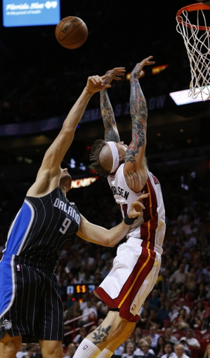 Apr 17, 2013; Miami, FL, USA;  Miami Heat power forward Chris Andersen (11) battles for a rebound against Orlando Magic center Nikola Vucevic (9) in the second half at the American Airlines Arena. The Heat won 105-93.  Mandatory Credit: Robert Mayer-USA TODAY Sports