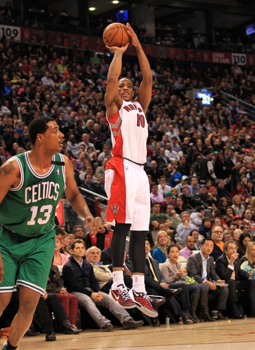 Apr 17, 2013; Toronto, Ontario, CAN; Toronto Raptors shooting guard DeMar DeRozan (10) shoots over Boston Celtics center Fab Melo (13) during the fourth quarter at the Air Canada Centre. The Raptors beat the Celtics 114-90. Mandatory Credit: Kevin Hoffman-USA TODAY Sports